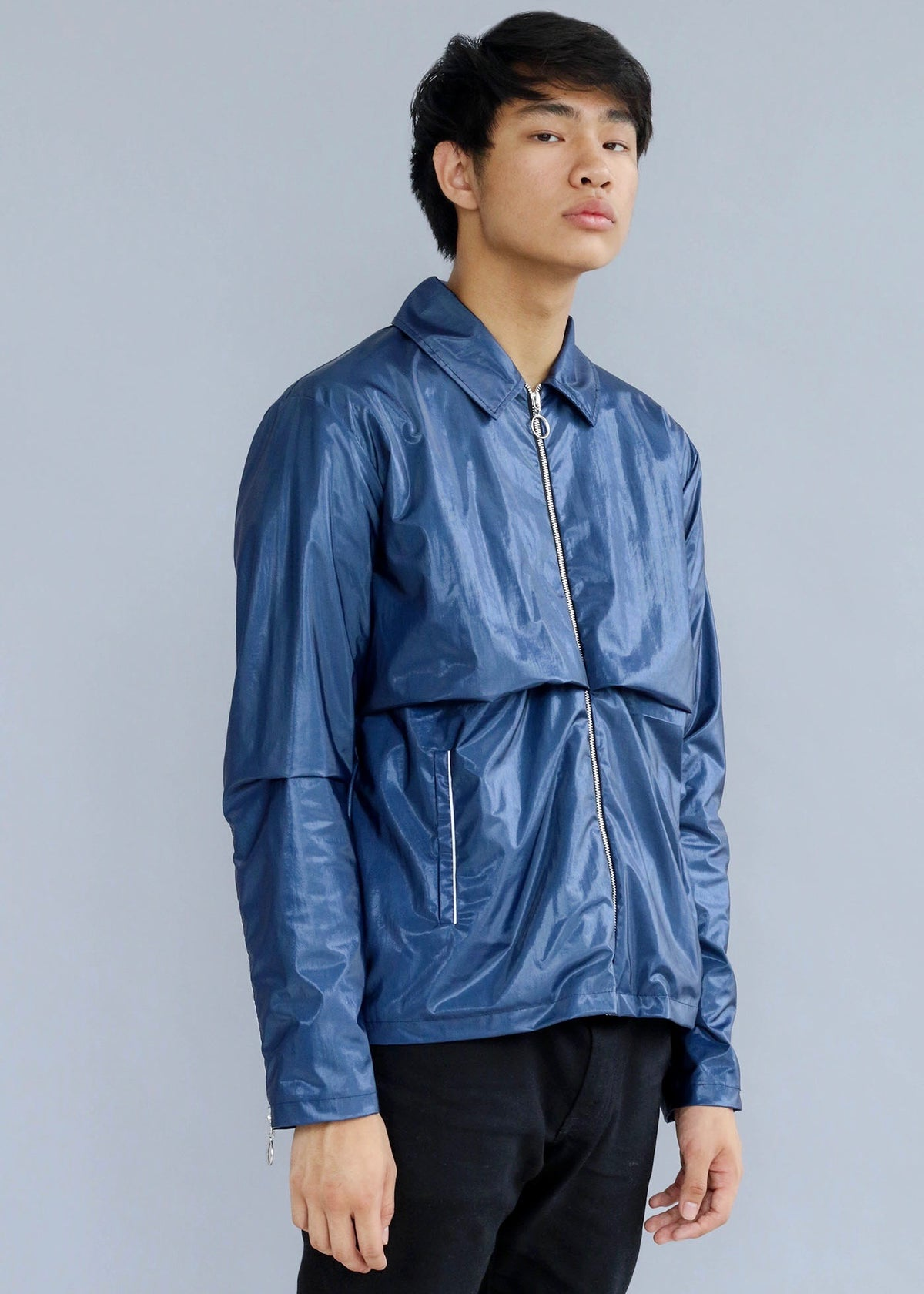 Shiny blue Nylon Shell Jacket featuring pipe trims and front layering from What We Wear by Tinie Tempah.