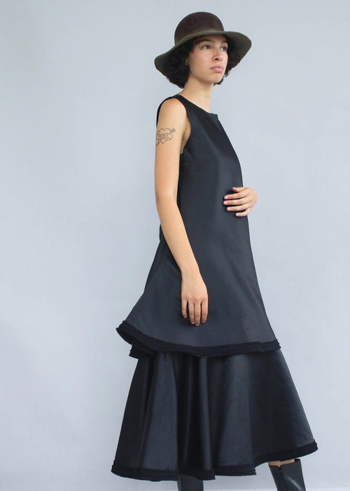 Voluminous black double layered formal dress with handmade ruffle trim from Nicholas Coutts