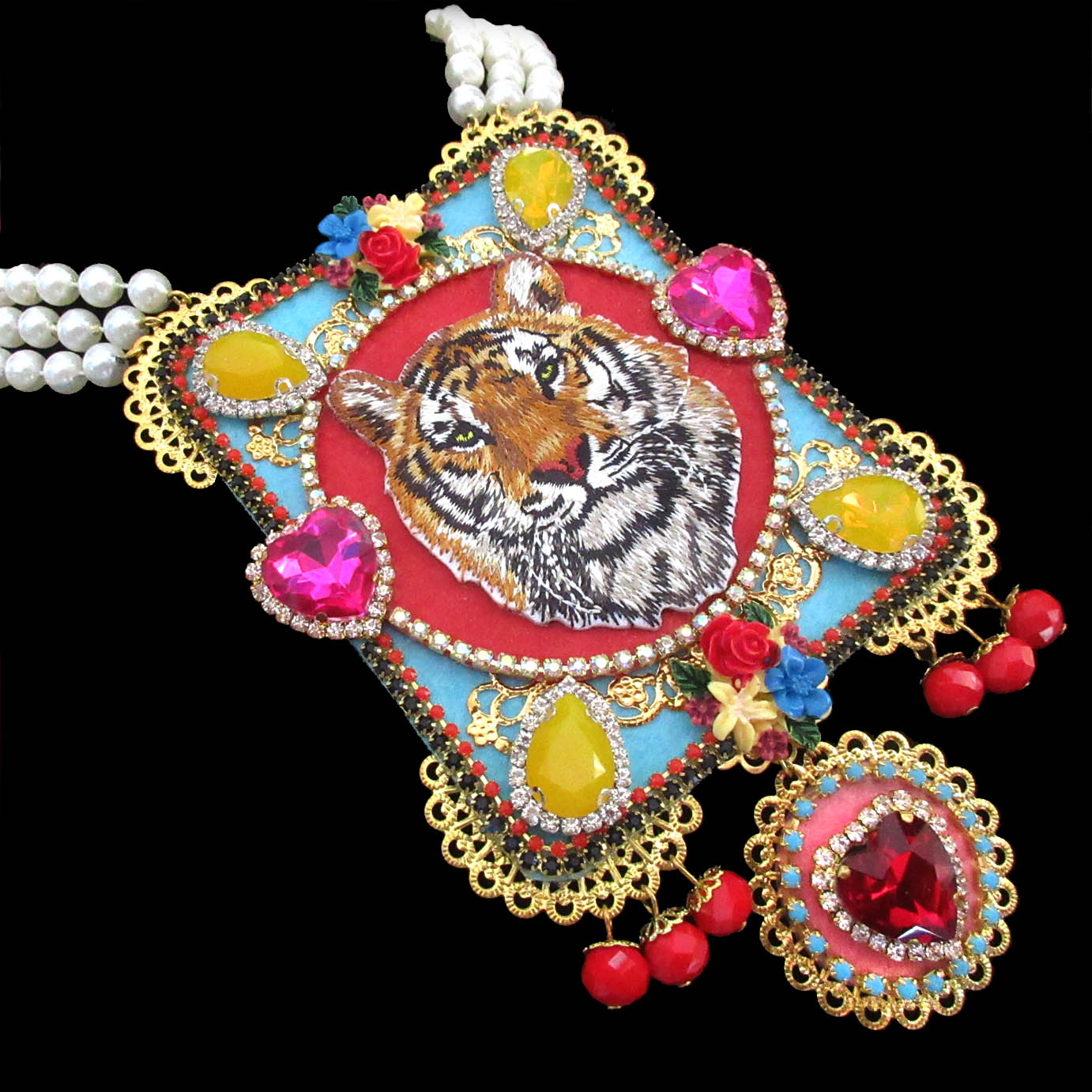mouchkine jewelry luxury tiger necklace, ornate with an embroided tiger, pink glass hearts, yellow chipped citrine stones, and delicate red glass pearls.