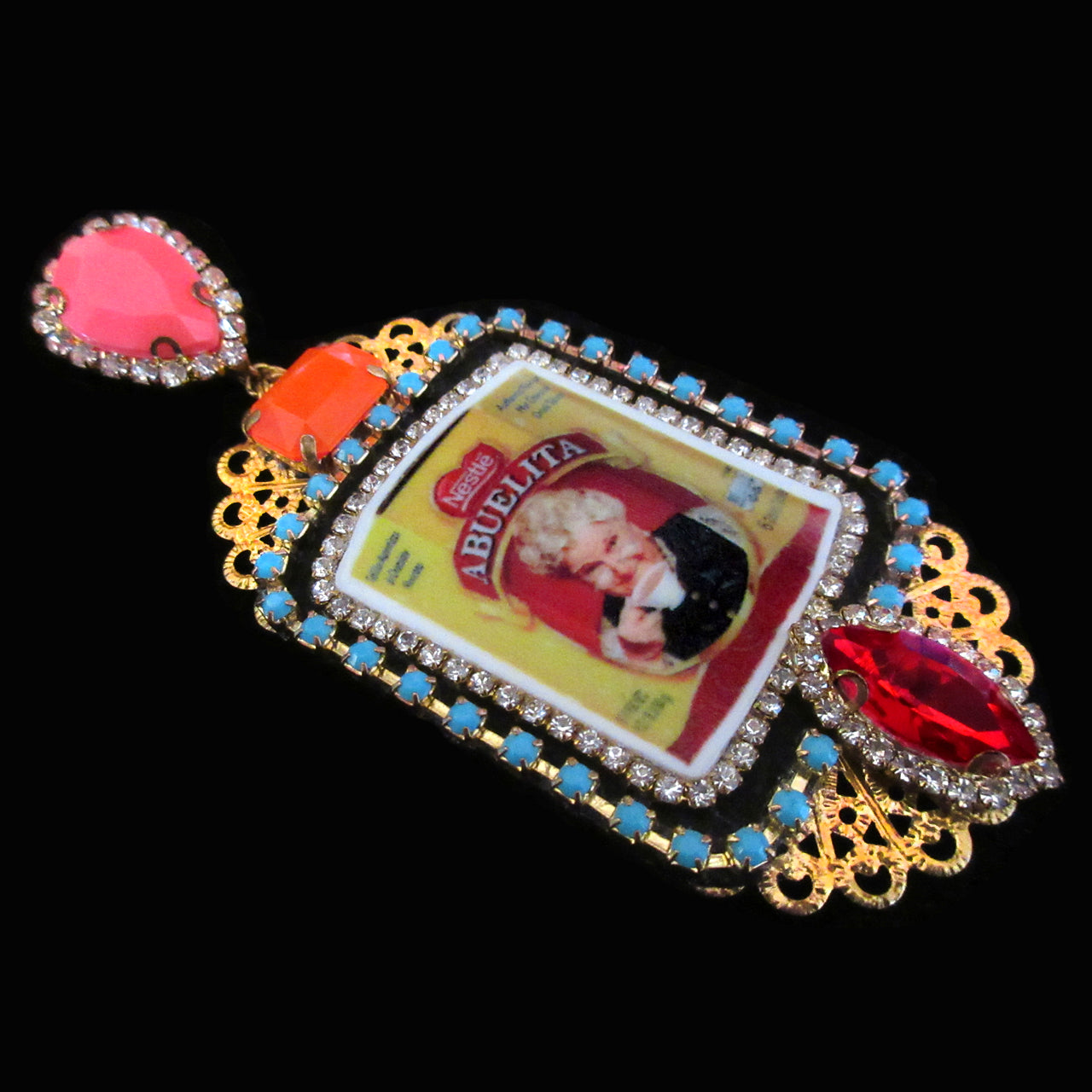 mouchkine jewelry earrings, an abuelita chic picture with red, pink and orange crystals. A luxury haute couture creation.