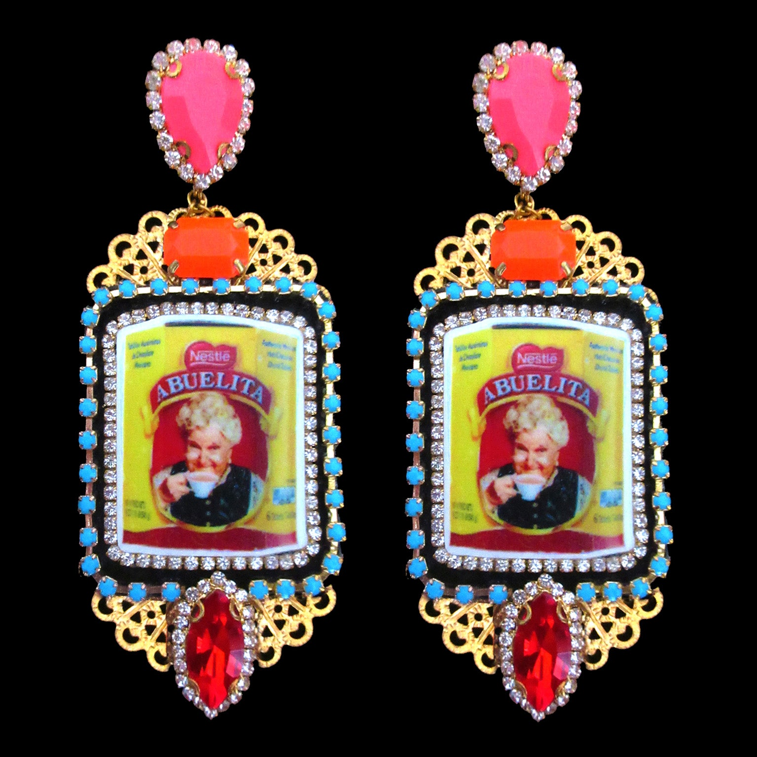 mouchkine jewelry handmade earrings, an abuelita chic picture with red, pink and orange crystals. A luxury haute couture creation.