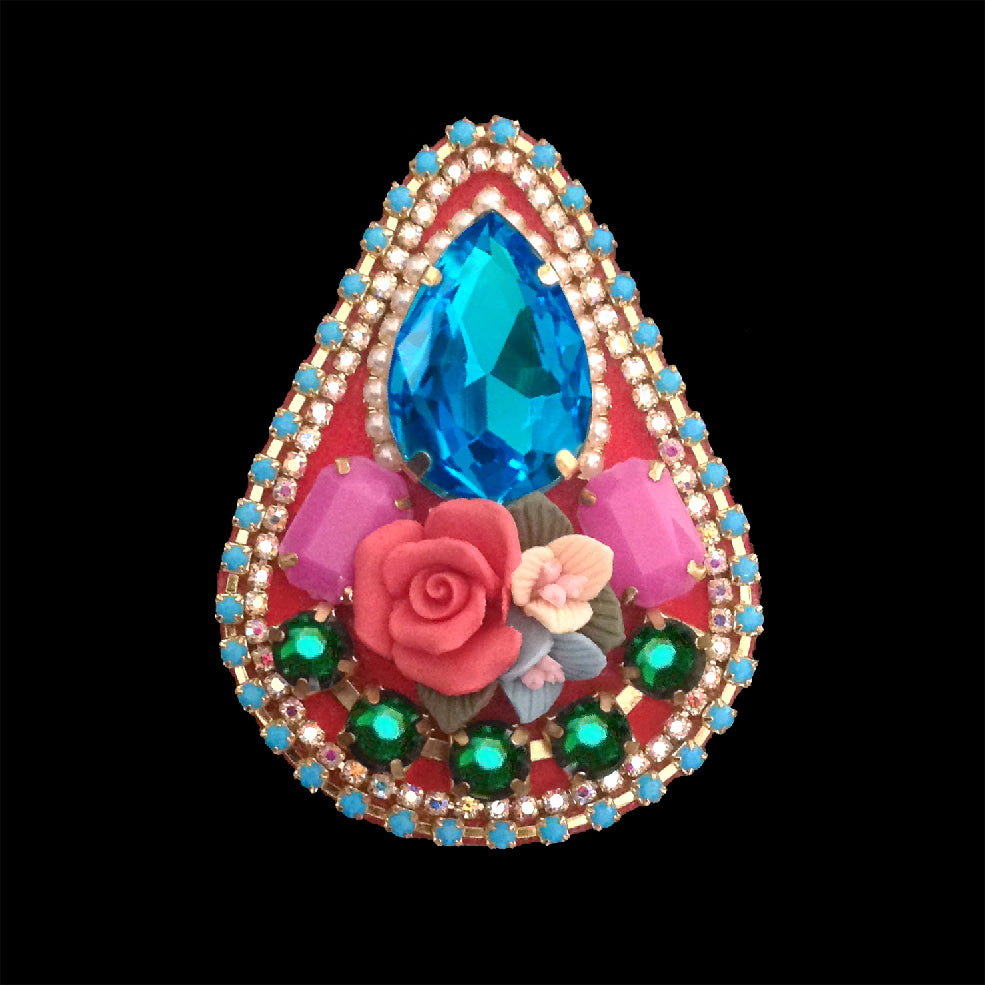 mouchkine jewelry couture sophisticated brooch with blue rhinestone teardrop and ceramic flowers