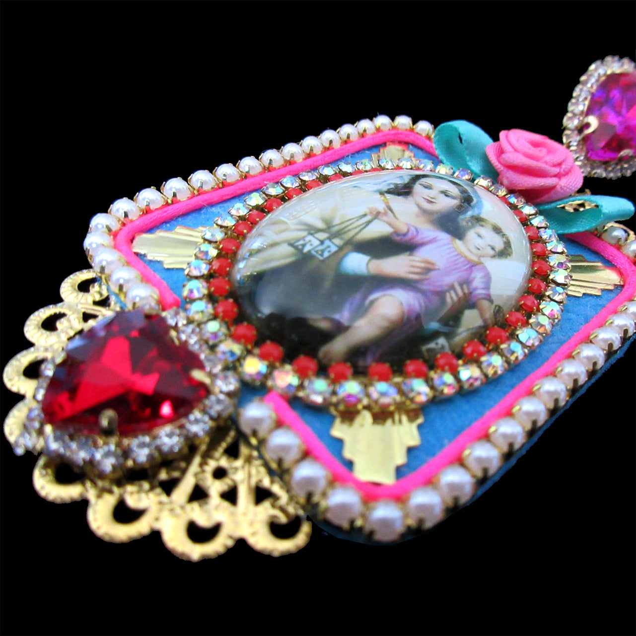 mouchkine jewelry handmade in france earrings. A madonna under glass surrounded by pink and red swarovski rhinestones. Chic and trendy.