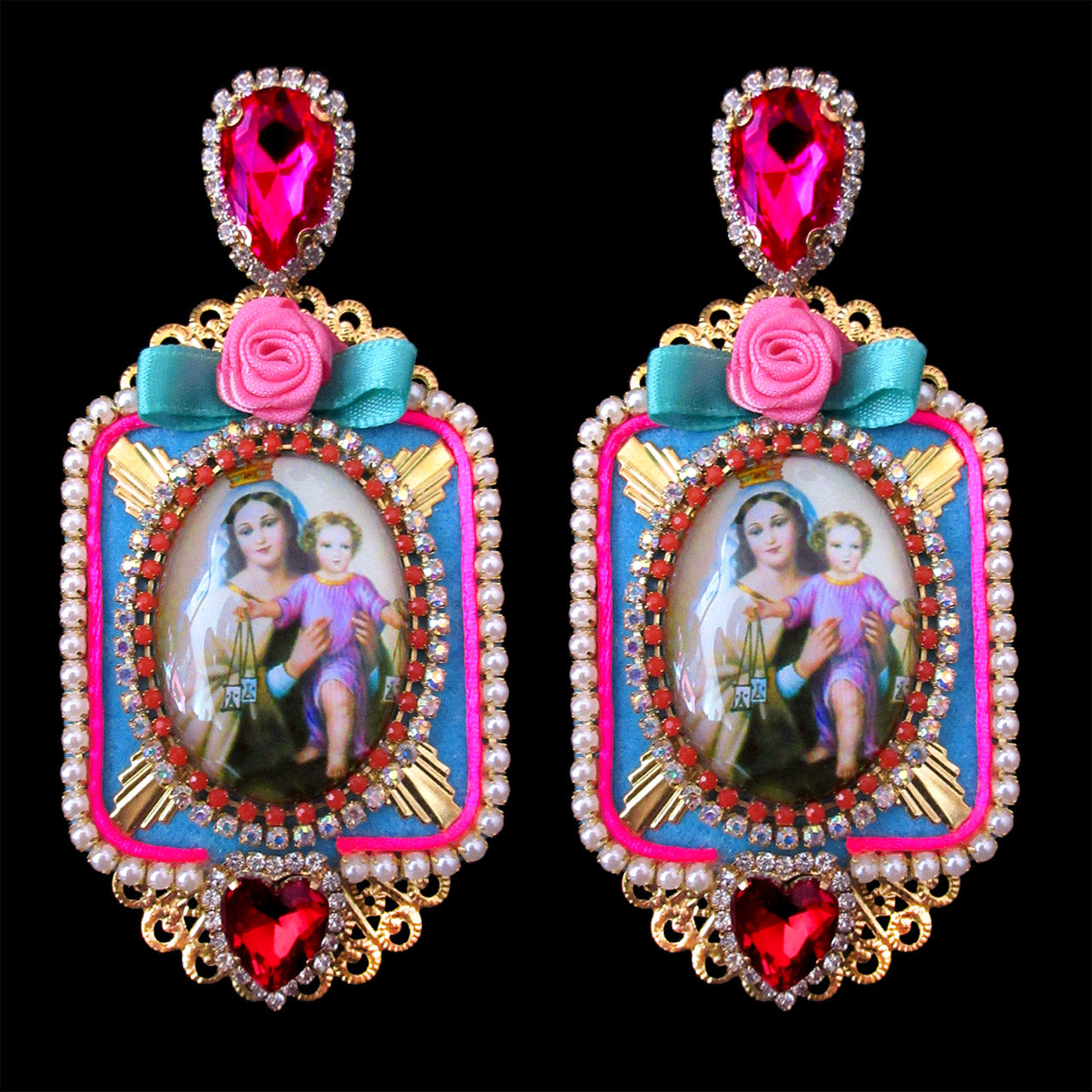 mouchkine jewelry handmade in france luxury couture earrings. A madonna under glass surrounded by pink and red swarovski rhinestones.
