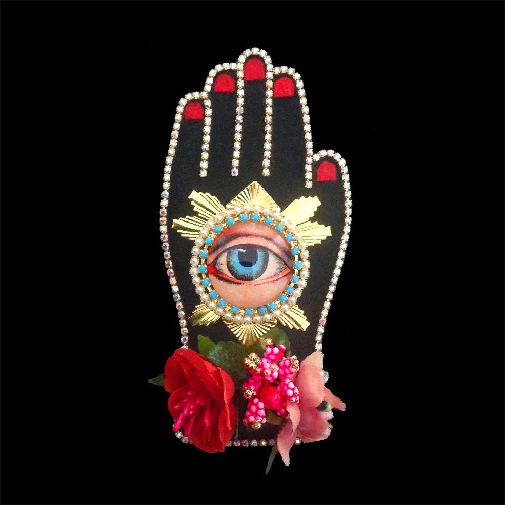 mouchkine jewelry couture and sophisticated hand brooch with antique eye, surrounded by flowers