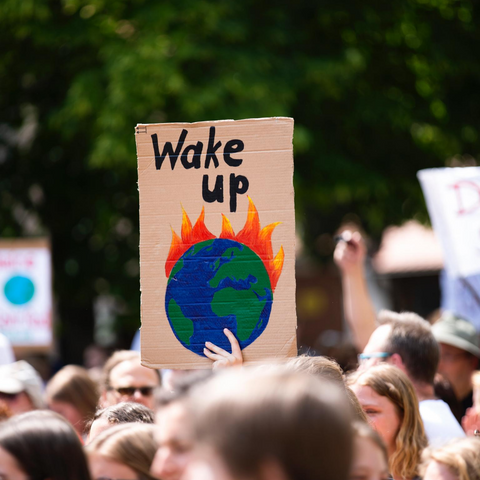 'Wake up' environmental protest sign