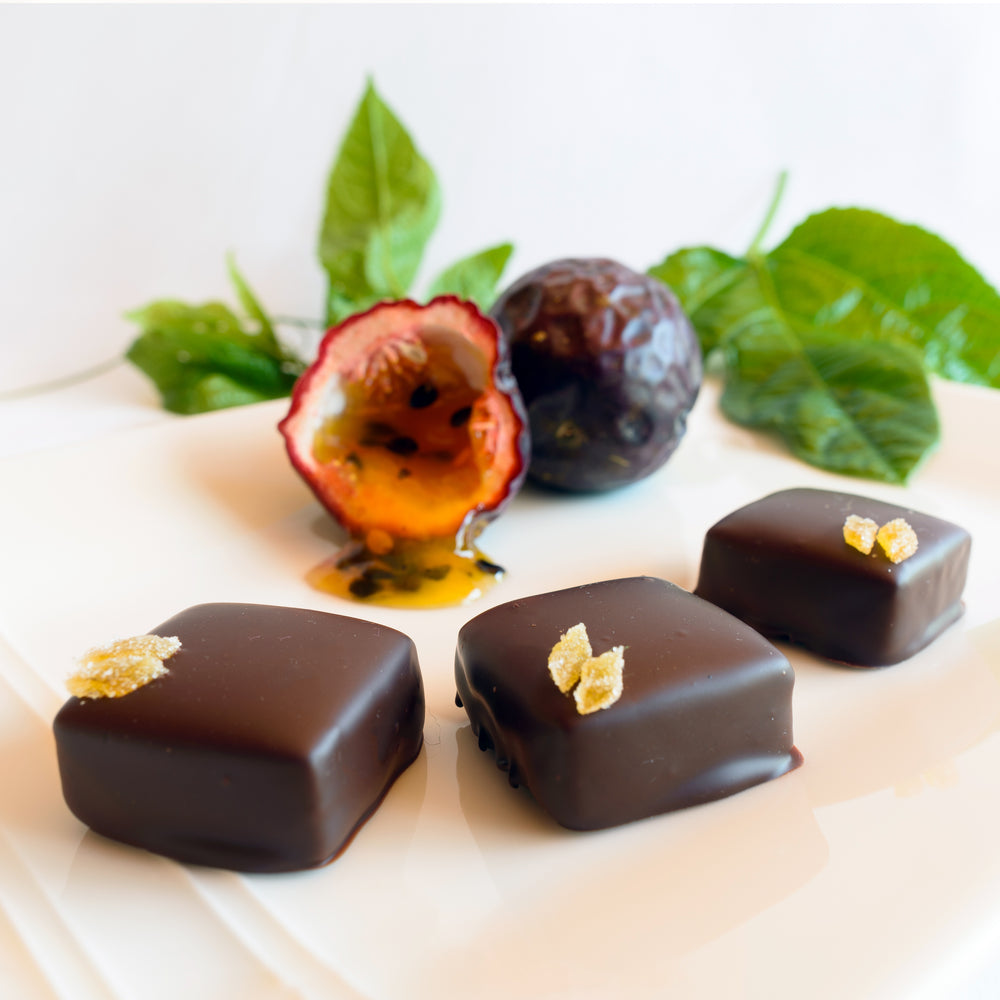 A layer of hazelnut gianduja topped with passionfruit pâte de fruit dipped in dark chocolate.