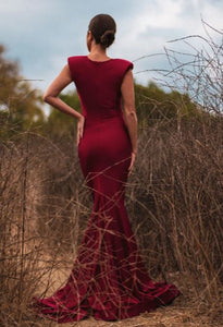 Burgundy long dress - Gowns. Couture style gown is crafted from luxurious stretchy fabric, with a v-shaped neckline, shoulder pads, and a mermaid shape