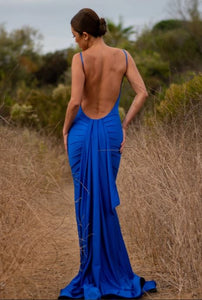 Blue Low Back Long Dress / Miami Fashion Woman Online StoreSewed to a figure hugging dress. This blue dress showcases sensuous side. The back details are a running theme here; a low back with a long train. It's imbued with a vintage allure that feels elegant and timeless. Designed and made in USA.