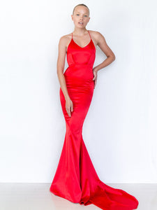 Ruby Red Satin Floor Length Gowns. Long Dresses. Miami women fashion for sale. Get swept off your feet in Ruby dress, timelessly elegant with a hint of drama. This beautiful red stretch satin elongates your form with its floor length cut and luxuriously radiant finish. Designed in Malibu. Made in USA.