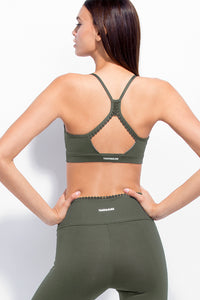 Cloud Nine Sports BRA Army Sportwear. 100% PIMA Cotton. Classic muscle tank style. Wavy neckline. Metal eyelets and criss cross straps in front. Model wearing US size Small. Best women fashion designer brands. Dresses, sportwear, shirts, skirts, pants, belts, handgabs and accesories online.