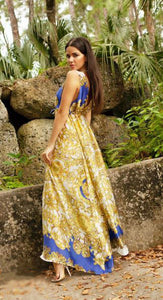 Gold & Blue Long Dress Resort and beach fashion wear. Produced locally in Miami. This style is perfect bikini with the last fashion trends. We have a high-quality resort wear, fabrics and perfect fit for all body types. Miami Fashion Woman Swimwear Dresses Store. Long blue and gold dress . V-neck and sleeveless dress.
