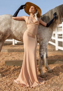 Get swept off your fee in Malibu dress, timelessly elegant with a hint of drama. This beautiful nude taupe stretch luxurious fabric elongates your form with its floor-length cut. Custom made belt is included. Stylish Gown Nude - Long Dresses. Handcrafted in Malibu, CA. Miami fashion online store.