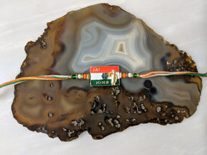 Golden Rakhi With Jai Hind Slogan Indian Flag (Tiranga) Color Beads Multicolor Thread Rakhi For Men