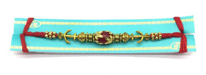 Tibetan Designer Gold Plated Red Gemstone Multicolor Thread Rakhi For Men