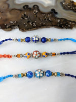 Digital Dress Room (Set of 3) Flower Rakhi for Men Blue Orange Beads Multicolor Thread Rakhi