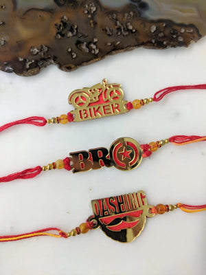 (Set of 3) Golden Rakhi with Dashing/ Bro/ Biker Slogan Beads Red Thread Rakhi For Men