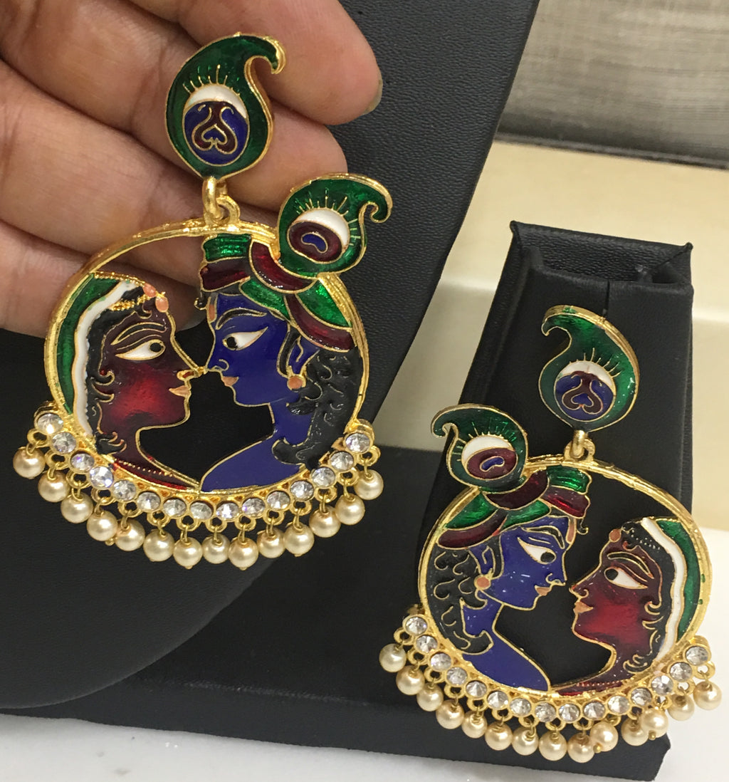 Beautiful Radha Krishna Dangling Earrings in Red Enamel work in Gold