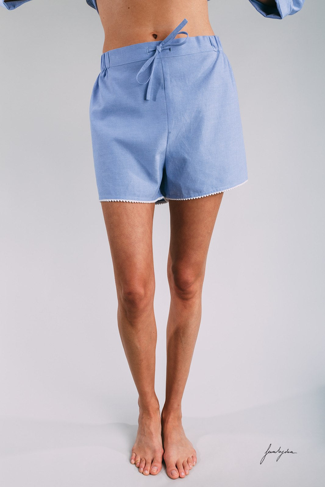 Siân Esther Shorty pyjama set created with blue cotton chambray and pompom trims. These Pjs make a perfect gift for a honeymoon, night before the wedding, special birthdays or Mother's Day. Luxe lounging in these pajamas.