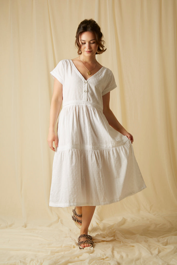 A beautiful white cotton nightdress with mother of pearl button up fastening, capped sleeves, pockets and cotton linen pleated details. A great nightie for night or day!