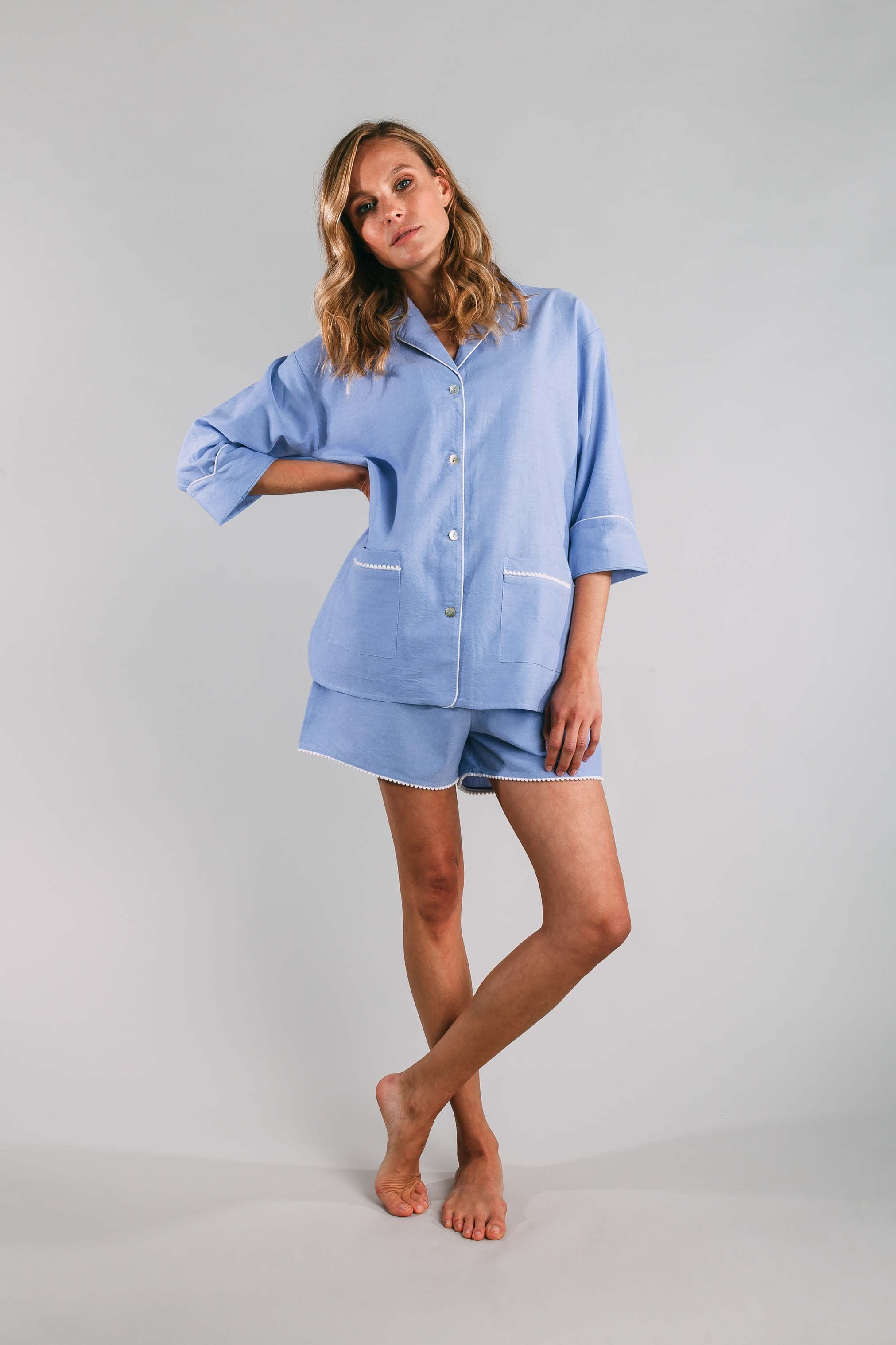 Siân Esther Shorty pyjama set created with blue cotton chambray and pompom trims