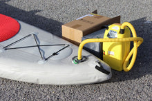 High pressure electric pump for inflatable boats and SUP's inflating a SUP.
