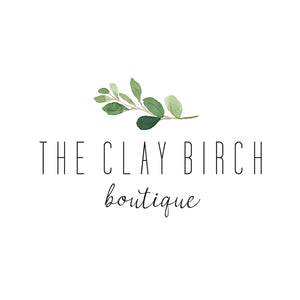 The Clay Birch Boutique Logo has a Birch Tree Branch with green leaves
