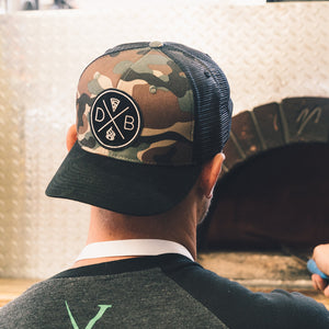 DB - Logo Seal Camo Trucker Hat