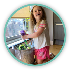 An image from a happy customer with her daughter playfully watering her Seedsheet Custom Container garden