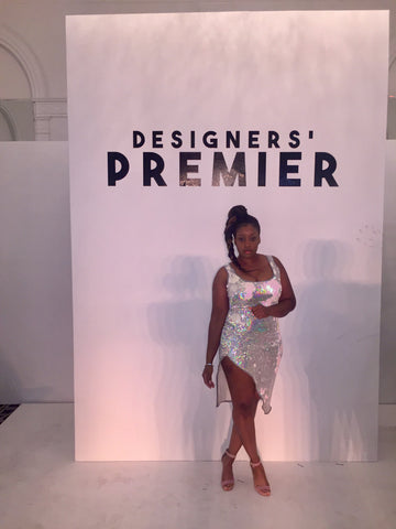 Fashion Designer Sade Glamour wearing a CUSTOM Sade Glamour dress at the NYFW Designers Premiere showcase
