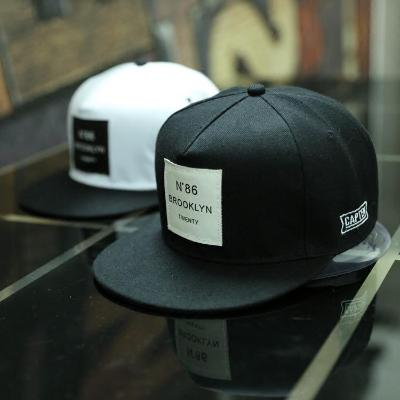 Blk - Wht BROOKLYN Letters Solid Color Patch Baseball Caps