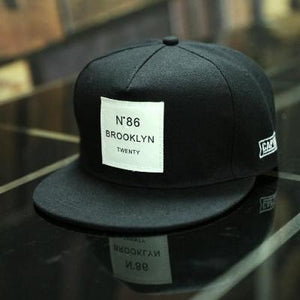 BLK BROOKLYN Letters Solid Color Patch Baseball Cap Front