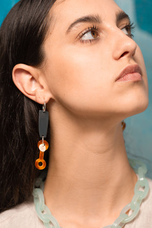 Model wearing Chain Link Hoop Bianca Mavrick Jewellery colour-coated stainless steel tortoiseshell acetate sterling silver statement earrings costume jewellery