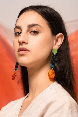 Model wearing Bianca Mavrick Jewellery Alta Earrings colour-coated stainless steel tortoiseshell acetate sterling silver statement earrings costume jewellery