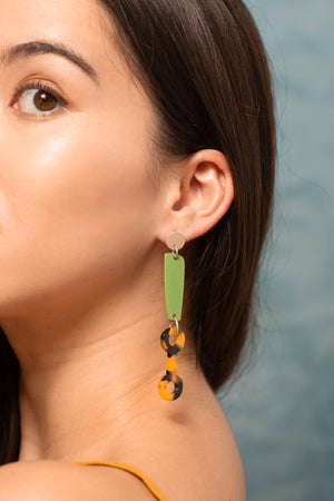 Model wearing Bianca Mavrick Jewellery Statement Acetate Earrings