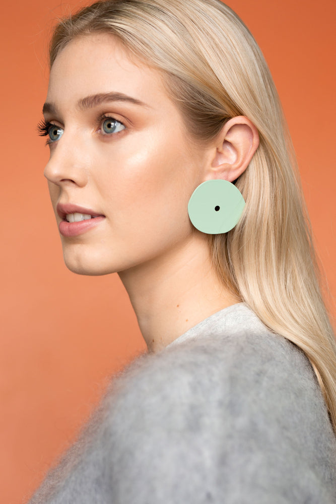 Model wear Bianca Mavrick Jewellery Earrings Eye Earrings Mint Oversized Disc Earrings