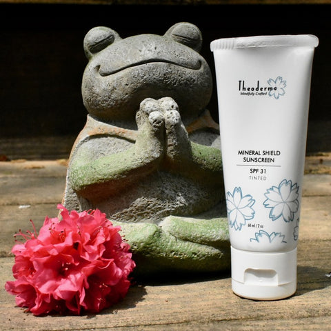 frog statue and Theoderma Sunscreen