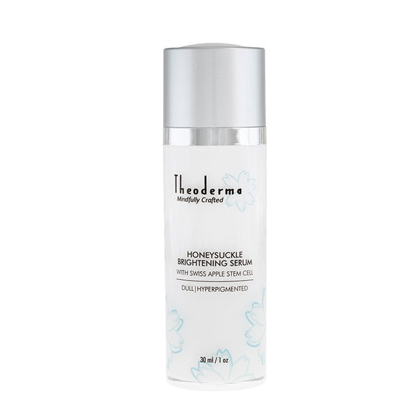 Natural Vegan facial skin brightening serum.  Theoderma white twist top bottle with matte silver top.