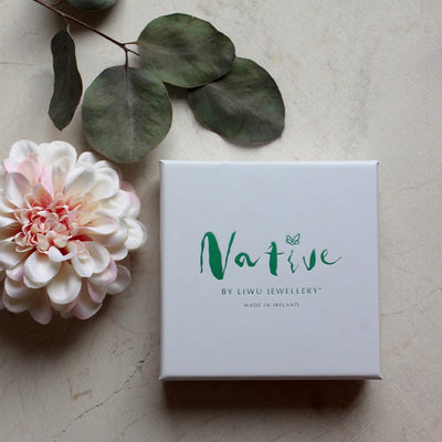 white box with green hot foil writing which says Native by Liwu Jewellery