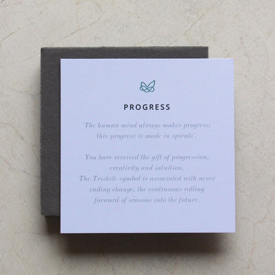 meaning card explaining that the triskele symbol means progress and included with necklace