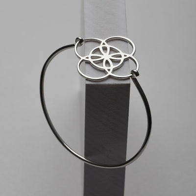 silver bangle with serenity symbol by irish jewelry brand liwu jewelry