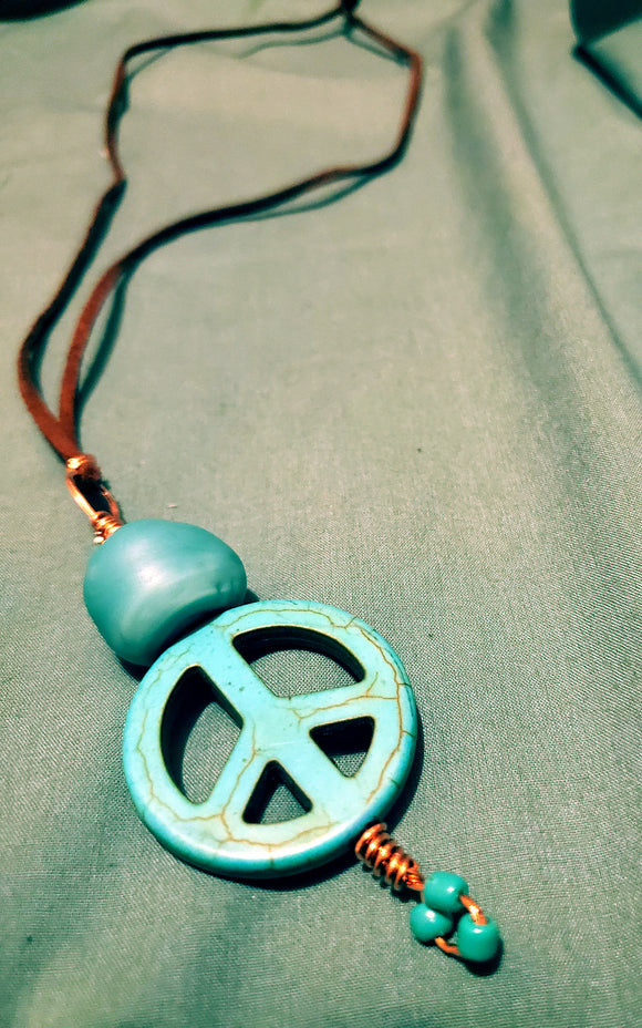 Turquoise Peace Pendant w/leather cording
