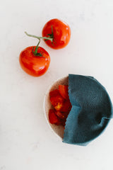 Keep cut tomatoes fresher longer by cover your bowl of tomatoes with a Goldilocks beeswax wrap