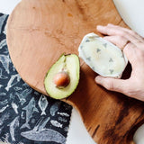 avocado wrapped with a goldilocks beeswax wrap from species of ucluelet print