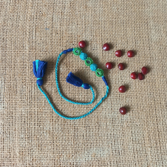 Turquoise Rakhi with Beads