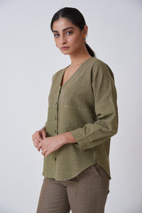 Girl wearing olive full sleeves top and brown pants