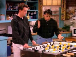 two men playing table football