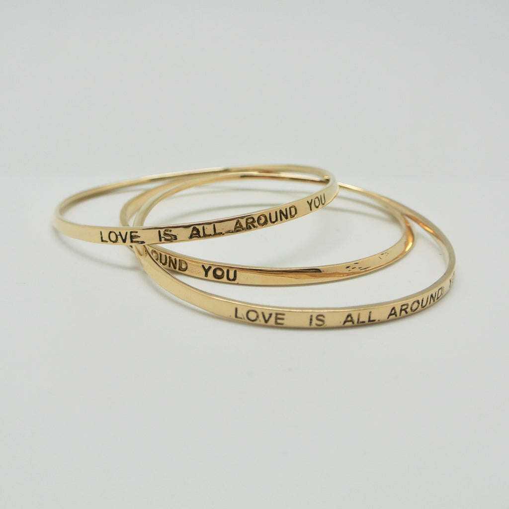 twang and pearl love is all around you bangle brass
