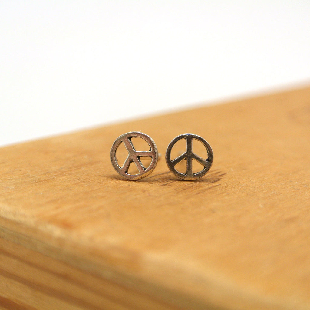 twang and pearl sterling silver studs peace cut out