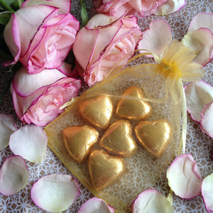 Sacred Love Hearts are presented in a gold organza bag
